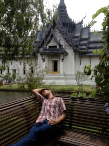 Bjorn takes it in easy near a recreated Ayutthaya palace in Ancient Siam, Samutprakan, Thailand. (Photo by Jammie Karlman)