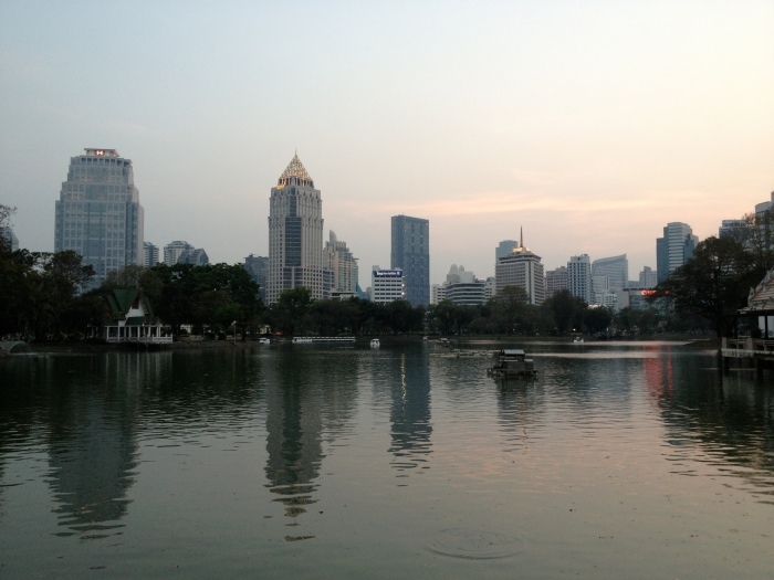 Sunset and cityscape can be seen from the banks of one of the lakes in Lumphini Park in Bangkok, Thailand. (Photos by Bjorn Karlman)