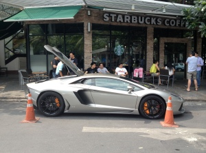 Nice cars are the norm (although not quite this high-end) on the streets of Bangkok. (Photo by Bjorn Karlman)
