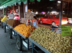 Fruit stands line a street in Bangkok, Thailand. (Photo by Bjorn Karlman)