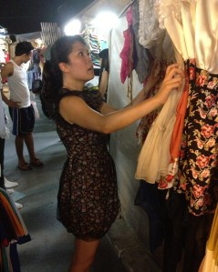 Me checking out the Thai fashions. Yes, I bought that dress in Thailand (I didn't say ALL the dresses were bad.) (Photo by Bjorn Karlman)